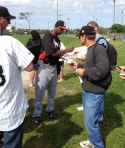 Juan Pierre signs for fans.