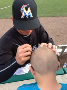 Rob Brantly signs for a kid.