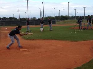 Gorkys Hernandez drops a bunt in drills.