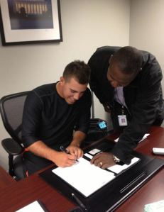 Jose Fernandez signs his first big league contract.