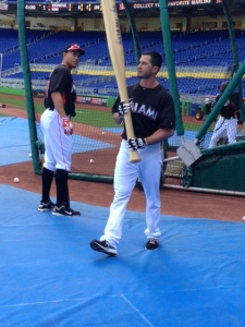 Justin Ruggiano has some fun during BP, bringing out a giant bat to break the stress of a team in a hitting slump.