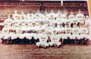 Team photo of 1947 Brooklyn Dodgers. Berman is sitting on the ground, on the right.
