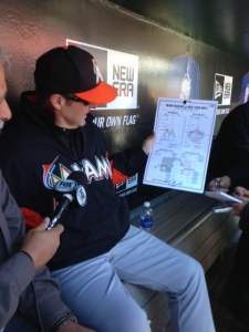 Mike Redmond presented the lineup card from his first big league win as a manager.