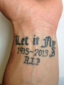 "'Let if fly"" tattoo displayed on Derek Dietrich's left arm."