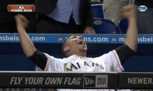 Jose Fernandez celebrates Giancarlo Stanton's home run.