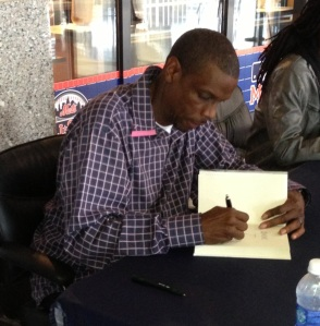 "Dwight Gooden signs copies of his new book, ""Doc"" for fans on Friday at Citi Field."