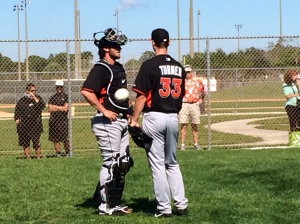 Jacob Turner chats with Jarrod Saltalamacchia as a baseball flings by at Marlins camp.