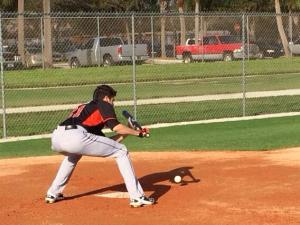 Christian Yelich working on his bunting.