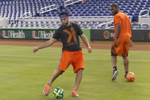Henderson Alvarez plays some soccer in the outfield on Friday. (Denis Bancroft/Miami Marlins)