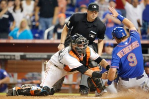 Jarrod Saltalamacchia tags out Kirk Nieuwenhuis to end game. (Jose Pineiro/Miami Marlins)