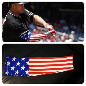 Giancarlo Stanton sporting stars and stripes sleeve on Fourth of July.